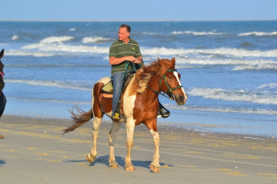 Oh hey. There's my dad riding a horse...