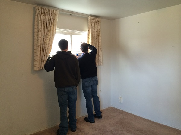 My dad and Jimmy inspecting the house.