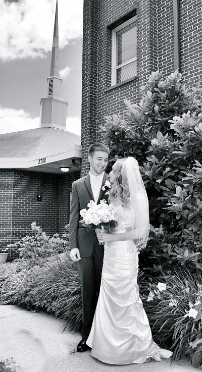Wedding picture outside of church bride and groom