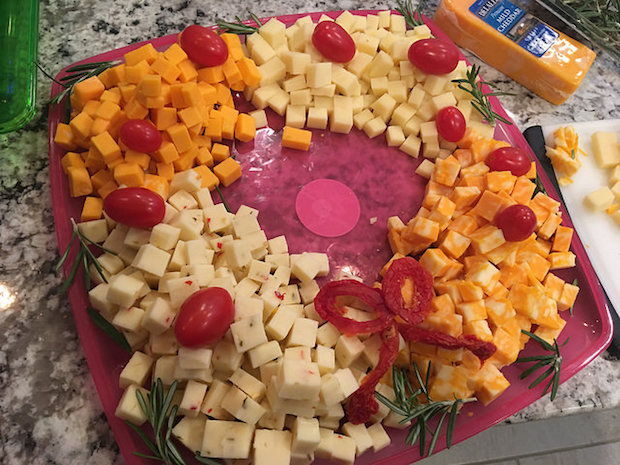 I made a cheese wreath at work last week for the family's Christmas party.
