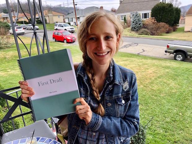 Girl holding first draft of novel
