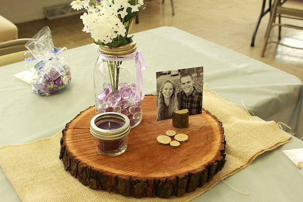 rustic wedding centerpiece with candle and mason jars