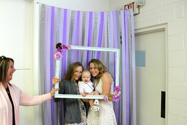 photo booth with frame and baby for wedding or bridal shower