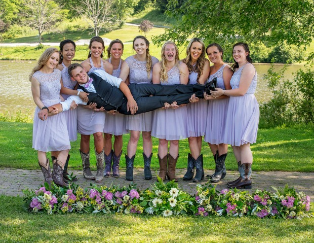 Bridesmaids holding groom