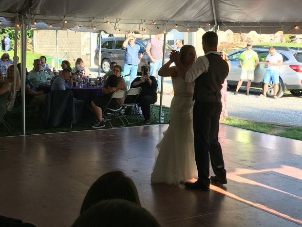 Bride and groom dancing at rustic country outdoor wedding