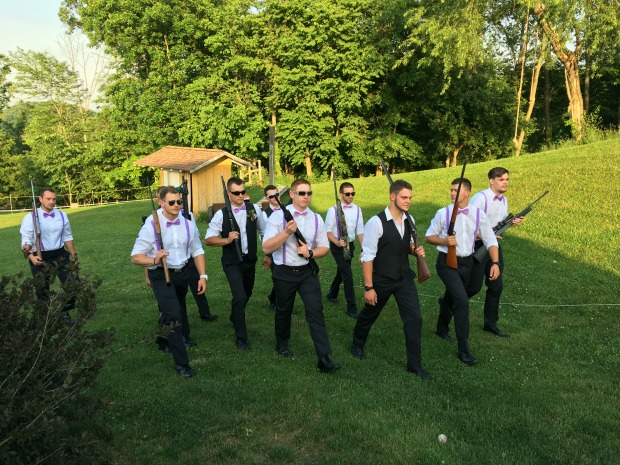 Groomsmen with guns