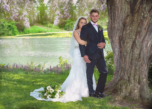 Wedding picture by lake in park