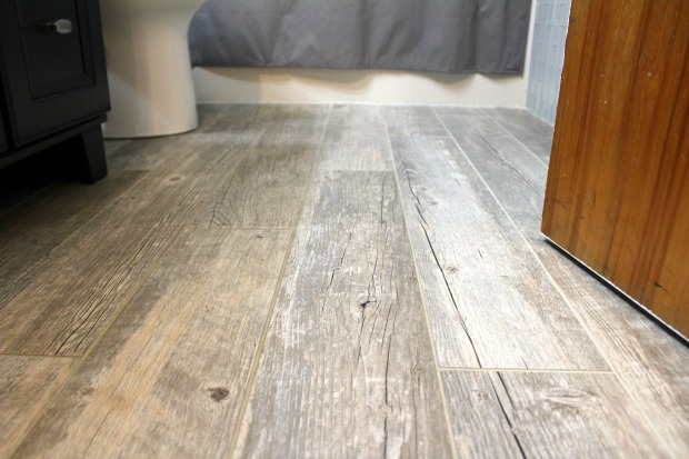 Gray woodgrain tile wood floor in bathroom