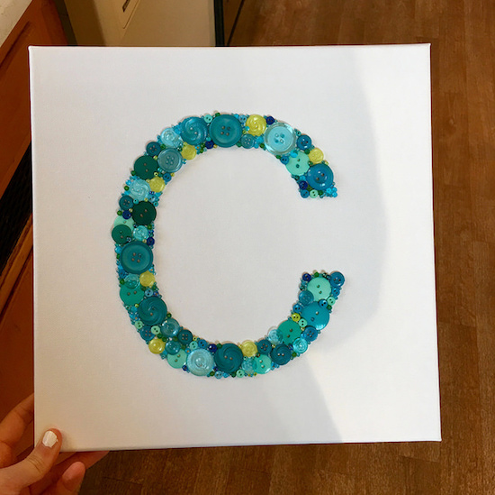 Blue and green C button art canvas