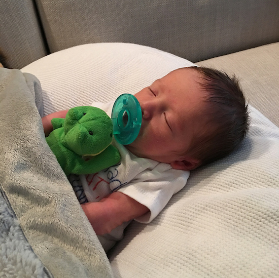 Baby with frog Wubbanub pacifier