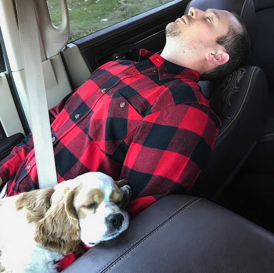 Man and puppy sleeping together