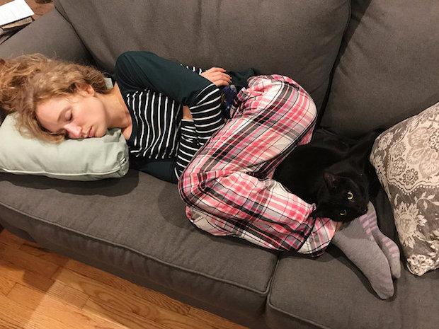 Girl sleeping with black cat