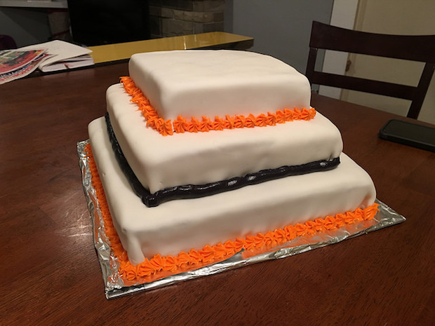 Three layer wedding cake with fondant and Harley Davidson colors