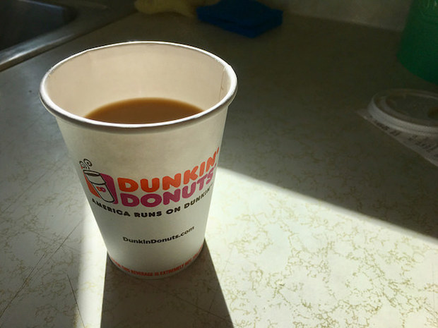 Small Dunkin' Donuts coffee with cream