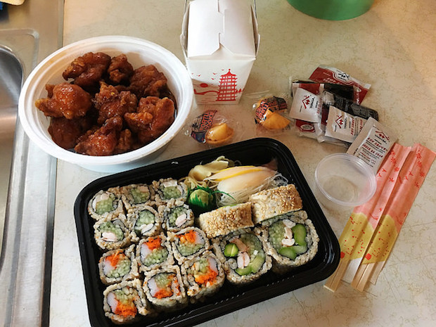 Sushi and General Tso's Chicken with fortune cookies, rice, soy sauce, and chopsticks from Osaka Pittsburgh