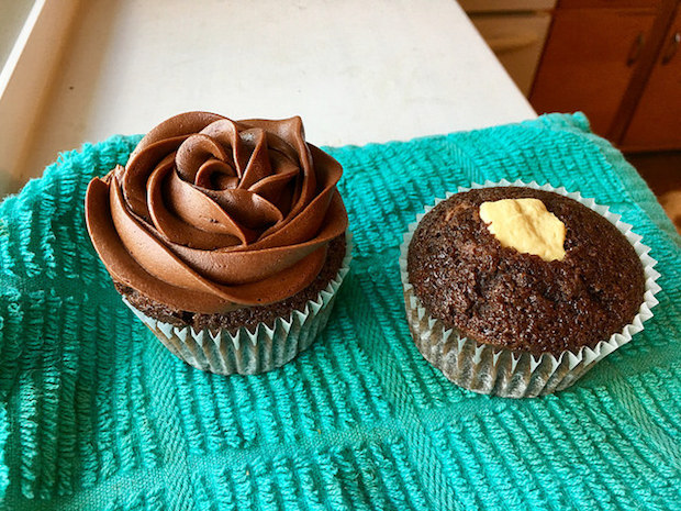 Chocolate cupcake with chocolate frosting and caramel filling for wedding