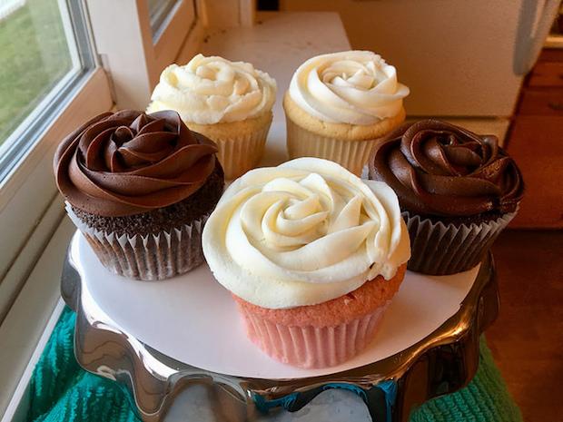 chocolate, strawberry, lemon, and vanilla cupcakes on cake stand