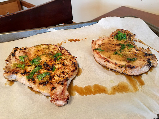 Bone in pork chops with glaze and fresh herbs