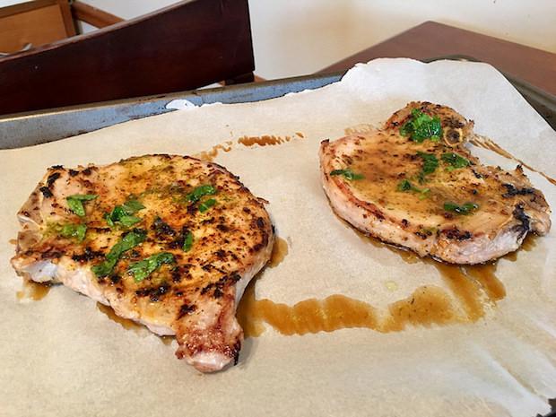 Bone in pork chops with glaze and fresh herbs