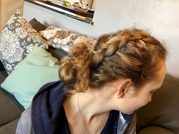 Blonde hair braided into dutch braid or french braid