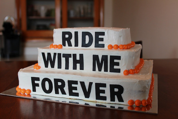 Harley Davidson black and orange wedding cake that says ride with me forever
