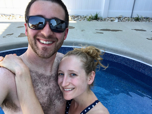 Young couple smiling selfie in pool