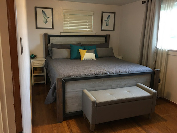 Industrial wood and steel bed with shiplap and gray quilt