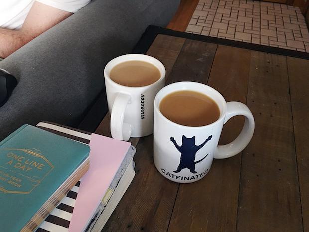 Angel's Cup coffee subscription in Catfinated coffee mug and Starbucks coffee mug