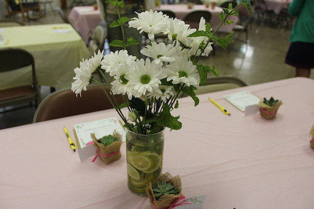 Daisy centerpieces with lemons and mint sprigs