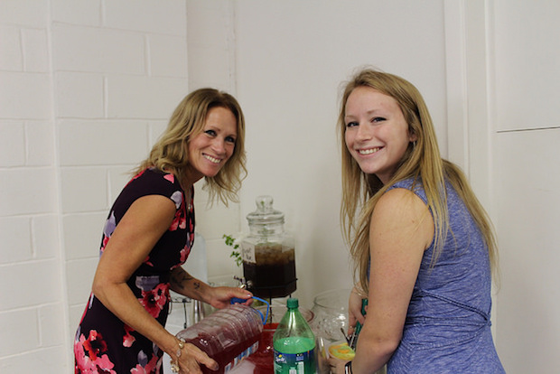 Mother and daughter pouring punch at baby shower