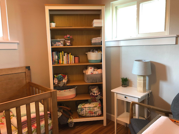 Baby girl bookshelf in nursery from Ikea