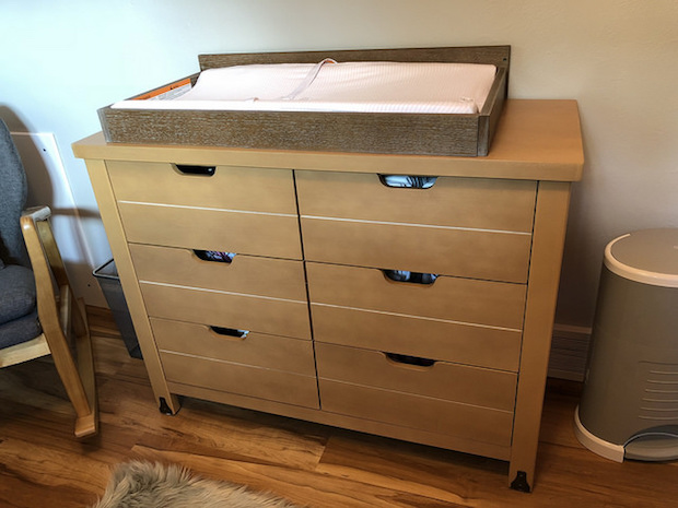Wood changing table from Target Baby Relax Ridgeline with Burt's Bees changing pad cover in Blossom stripe