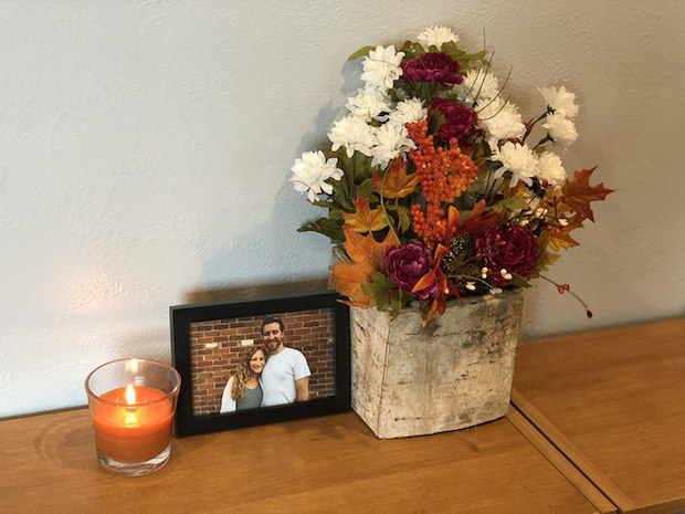 Fall flower arrangement with pumpkin candle for fall decor