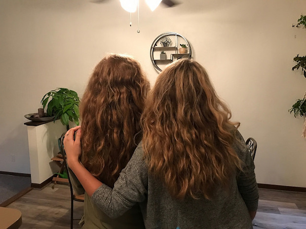 Hair twins girls with curly dark blonde hair