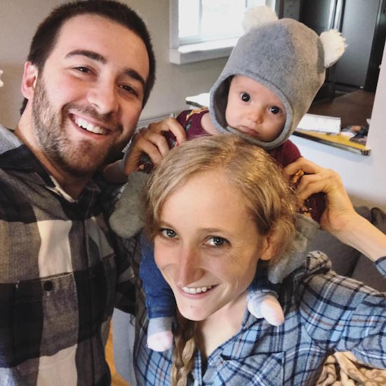 Family picture with baby on mom's shoulders