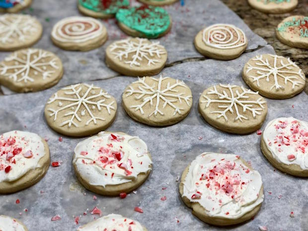 Christmas snowflake and peppermint sugar cookies decorated