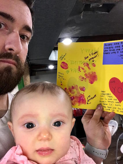 Dad and baby with homemade Valentine's Day card