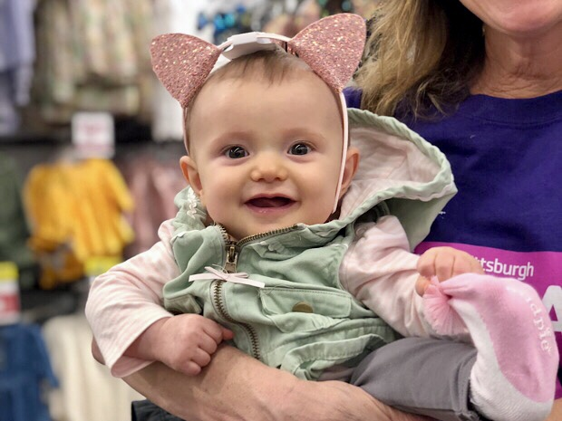 Baby girl wearing sparkly cat ears from Old Navy