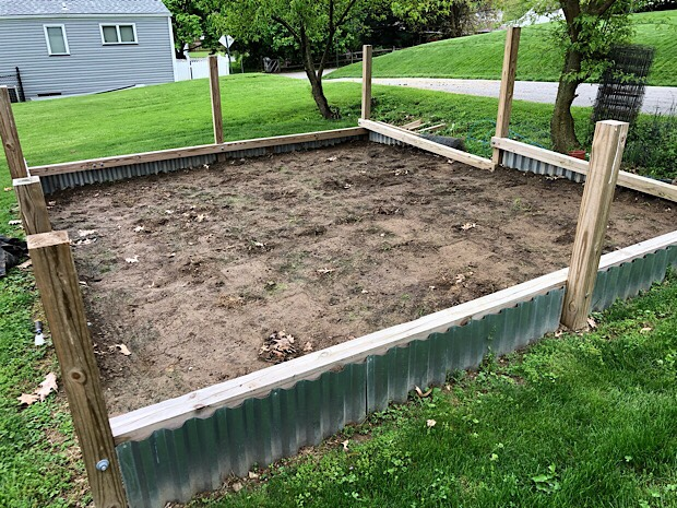 Vegetable garden plot with wood and steel base ready to be tilled