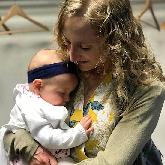 Mom holding baby girl