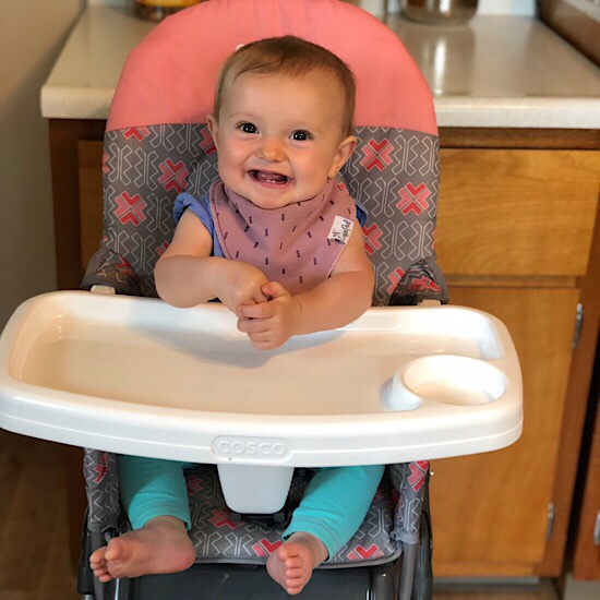 Baby girl sitting in highchair