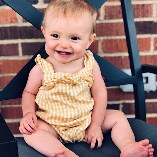 Baby in yellow gingham romper