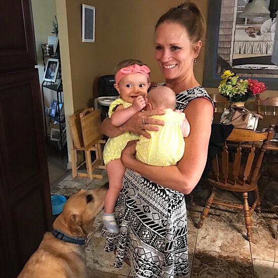 Grandma holding two baby girls