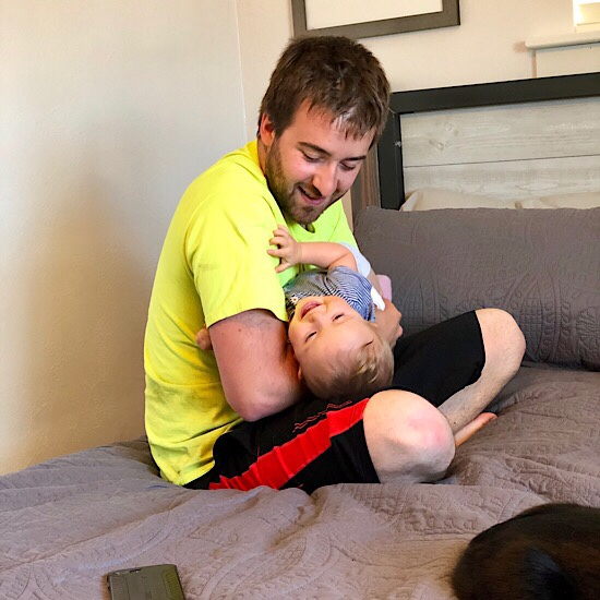 Dad holding baby and laughing