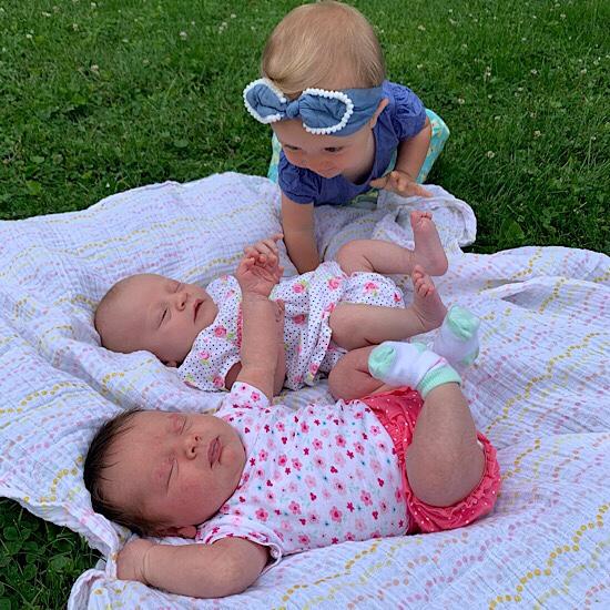 Baby with newborns