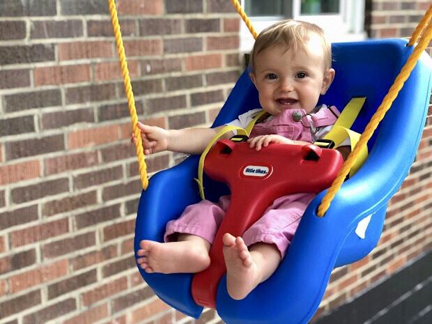 Baby in Little Tikes swing
