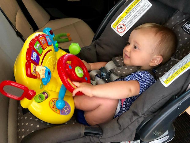 Baby in carseat with VTech Turn and Learn driver toy