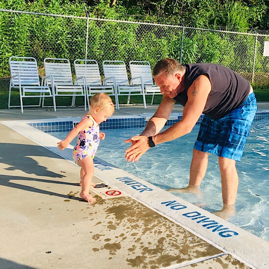 Grandpa and baby swimming