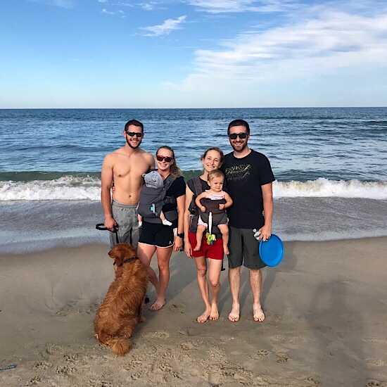 Couples on beach with dog and babies