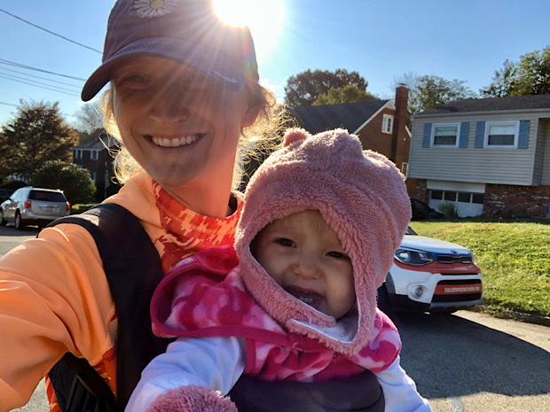 Mom and daughter smiling in cold weather on a walk outside